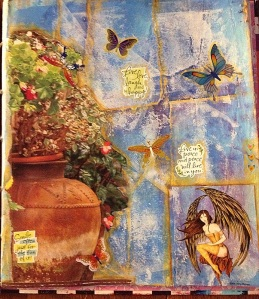 The potted plants are clipped from a magazine and the fairy is an Amy Brown sticker.  I love Amy Brown.